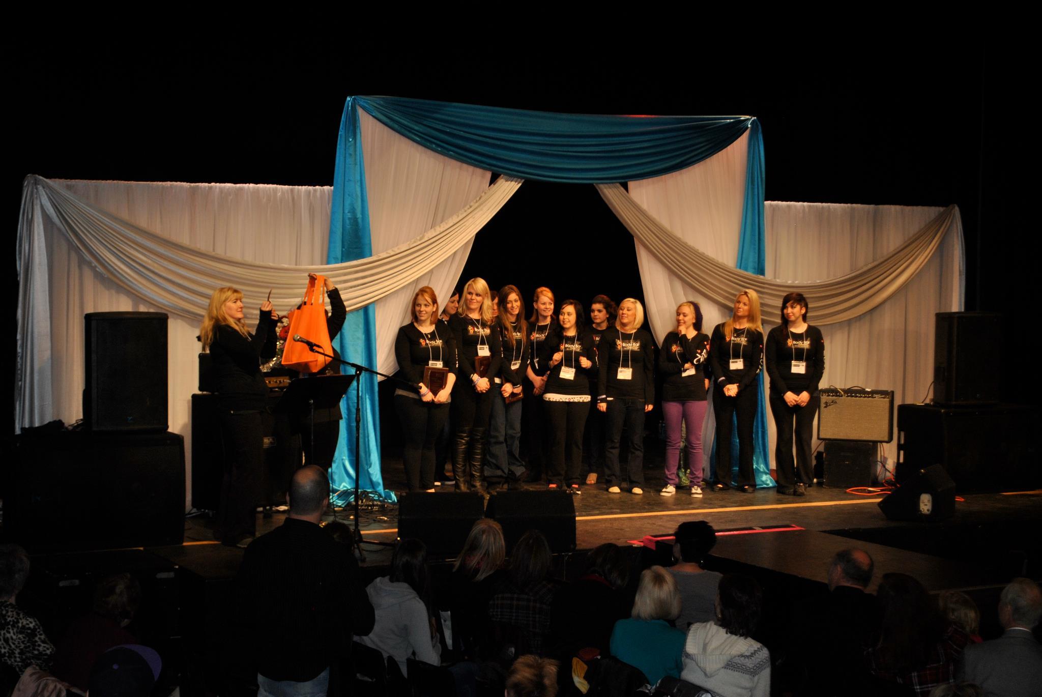 Team photo for Enchanted Wonderland fashion show, raising money for child help.