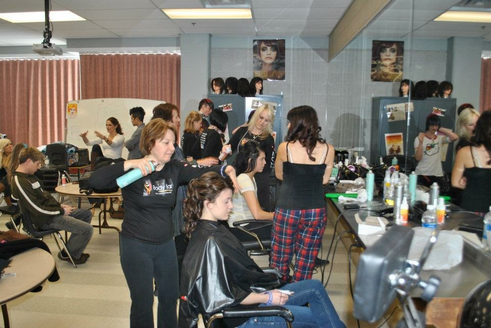 Back stage at fashion show getting models ready.